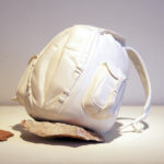 Melanie Vote sculpture: Backpack (2011) plaster, magic sculpt, found rock 6x6x6 in.