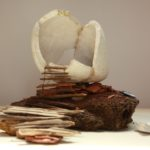 Melanie Vote: Head as Home (2010), maquette: unfired porcelain, cow pie, wood, other found materials, 10x10x12 in.