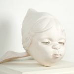Melanie Vote sculpture: Kissing Doll (2007), plaster, 12x12x12 in.