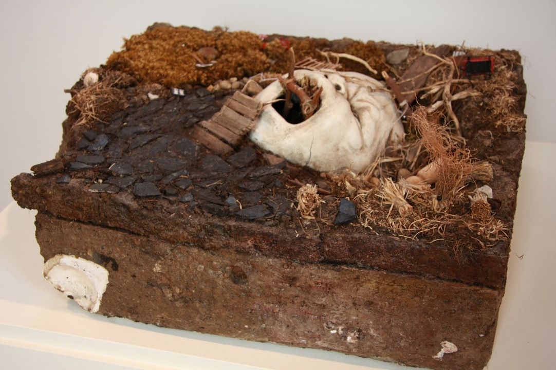 MelanieVote: Refuge in Ruins (2009), maquette made of dirt, plaster, sculpy, other found materials 8x24x36 in.